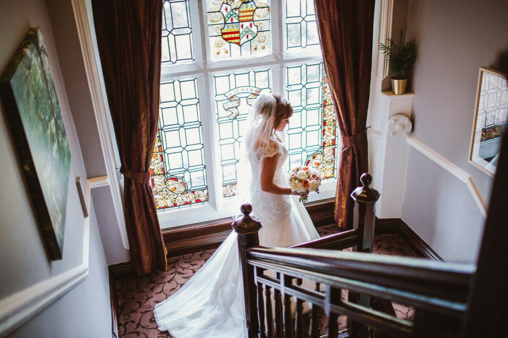 Bride walking downstairs - The Maynard wedding