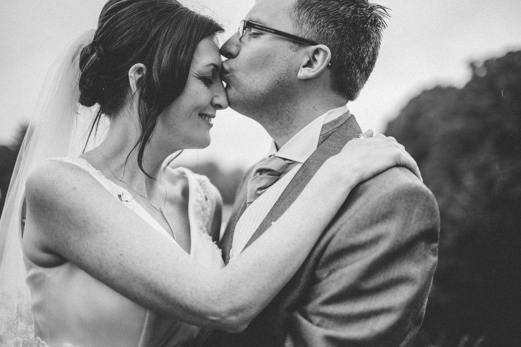 Bride and groom kiss - Shrigley Hall wedding