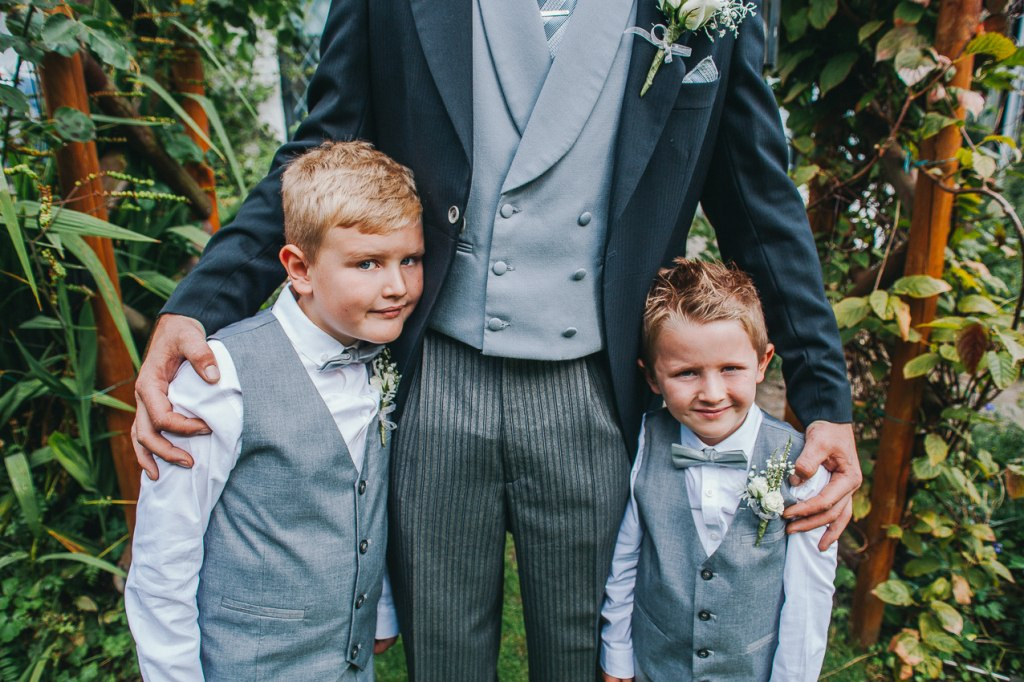Page boys with grey bow ties
