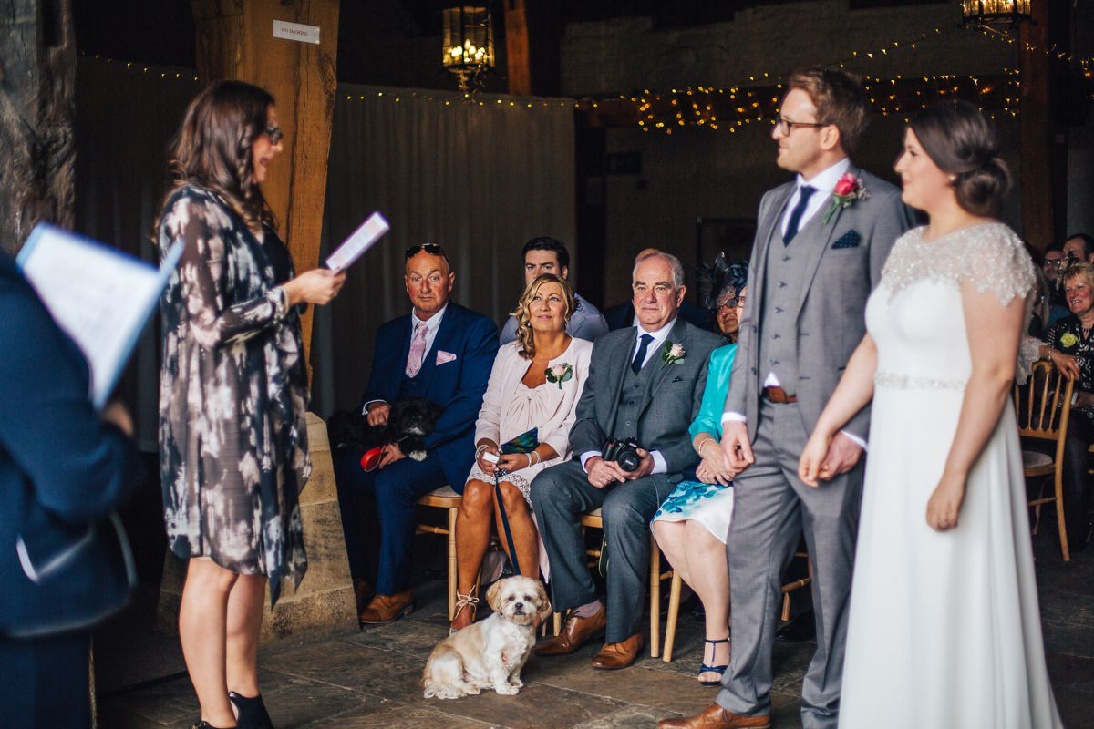 Guests at wedding ceremony, East Riddlesden Hall wedding venue.