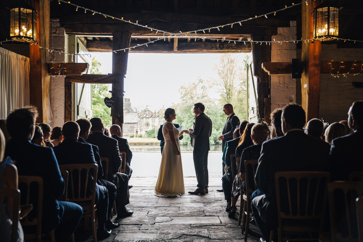 Exchanging vows, East Riddlesden Hall relaxed wedding venue.