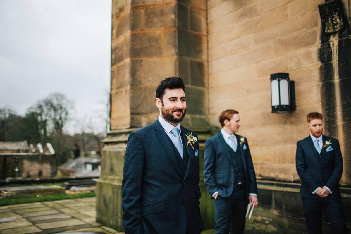 The groom wearing blue