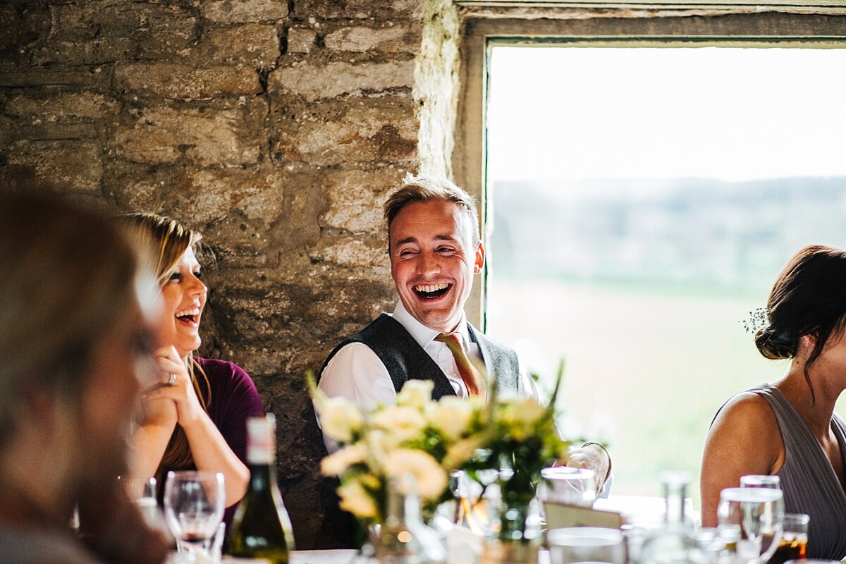 Guests laughing at the wedding speeches