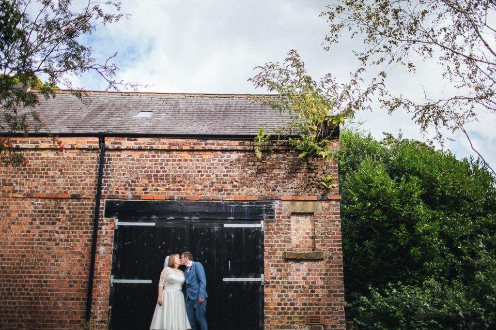 Tea length wedding dress and blue suit