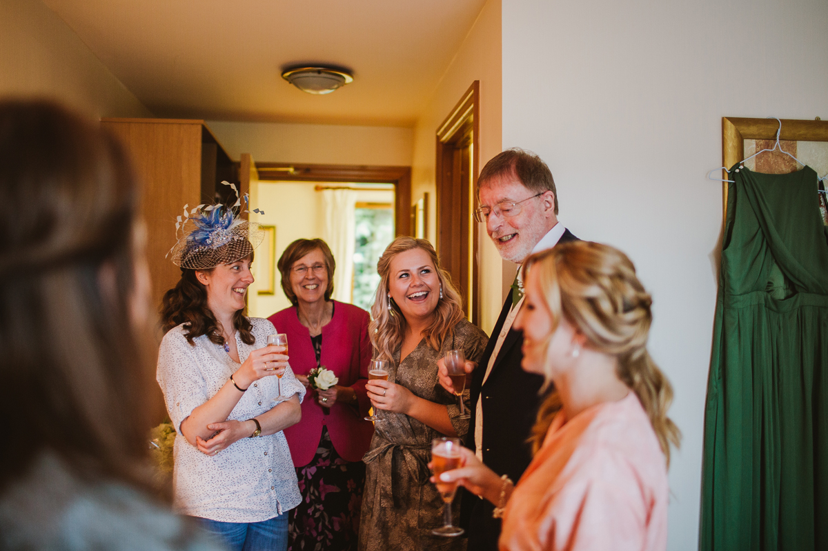 Family laughing with the bride