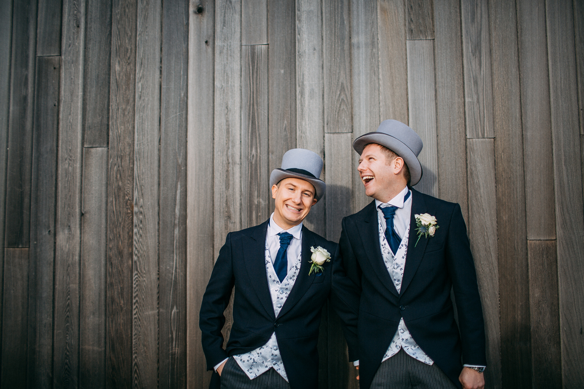 Grooms laughing at Manchester wedding