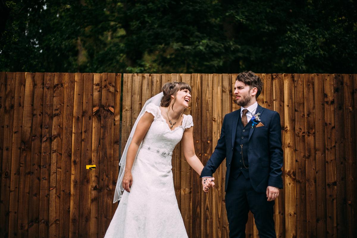 Couple laughing at Shustoke Barn wedding