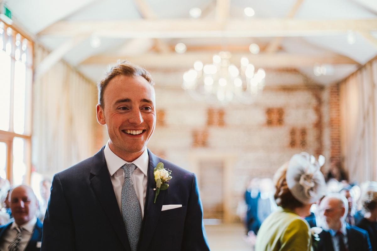 Groom at the barn wedding