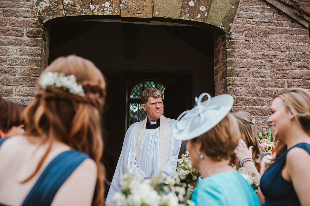 Vicar waiting for the bride