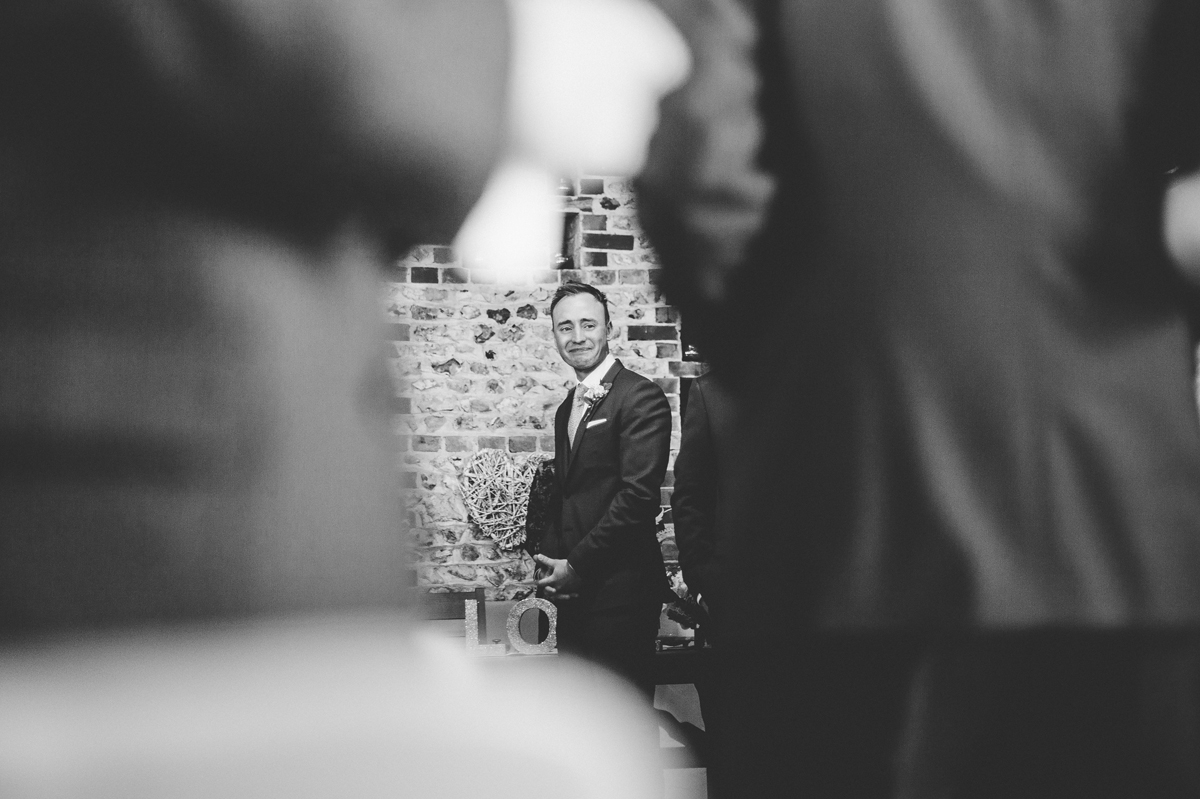 Groom's first look during the ceremony