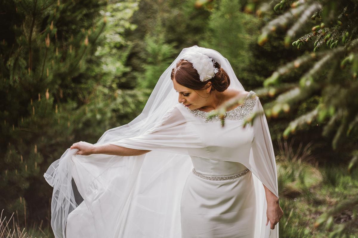 Bride's satin dress and feather headband