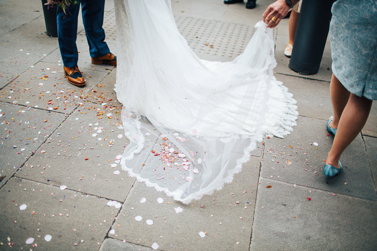 Bride's veil amongst the confetti