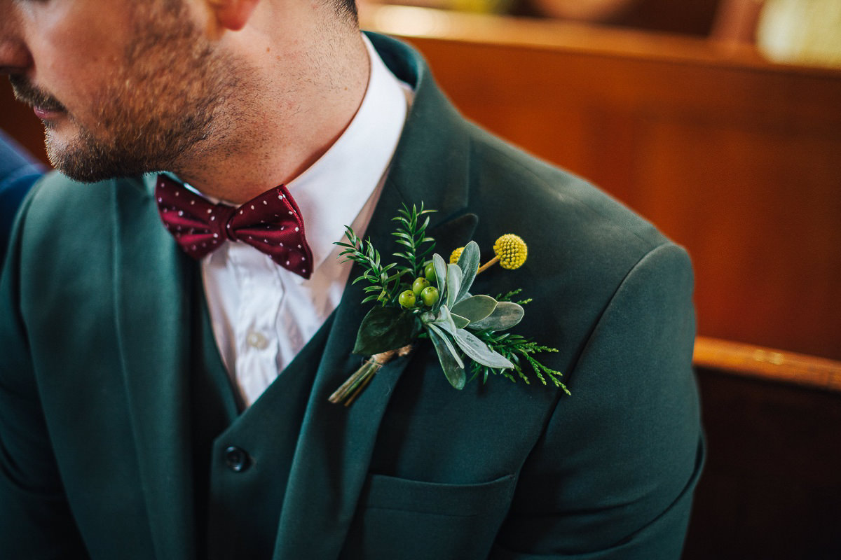 Groom's green suit and buttonholes