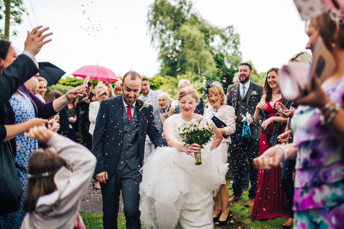 Confetti throw Lancashire farm wedding