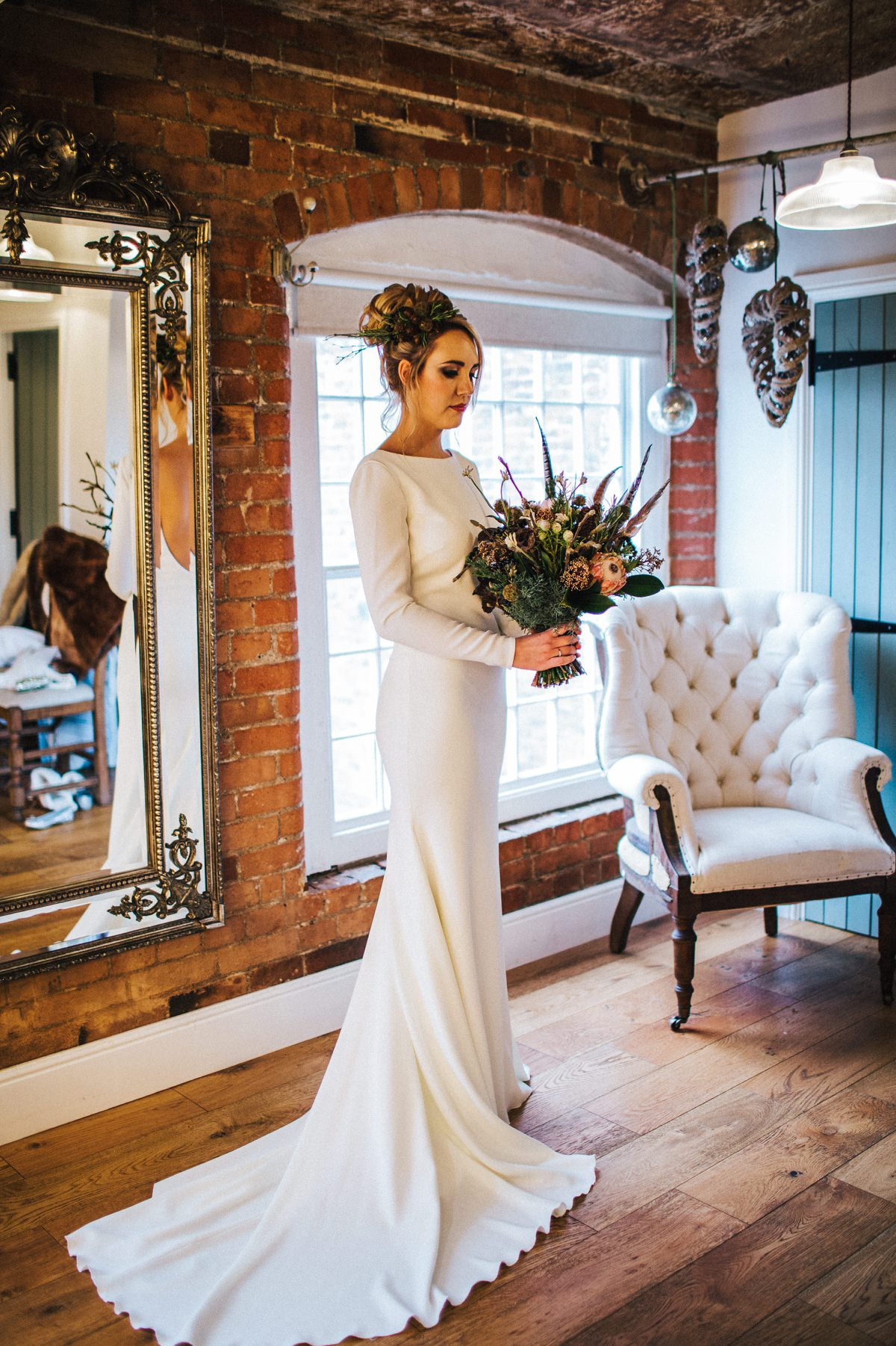 The Bride in her long sleeved dress