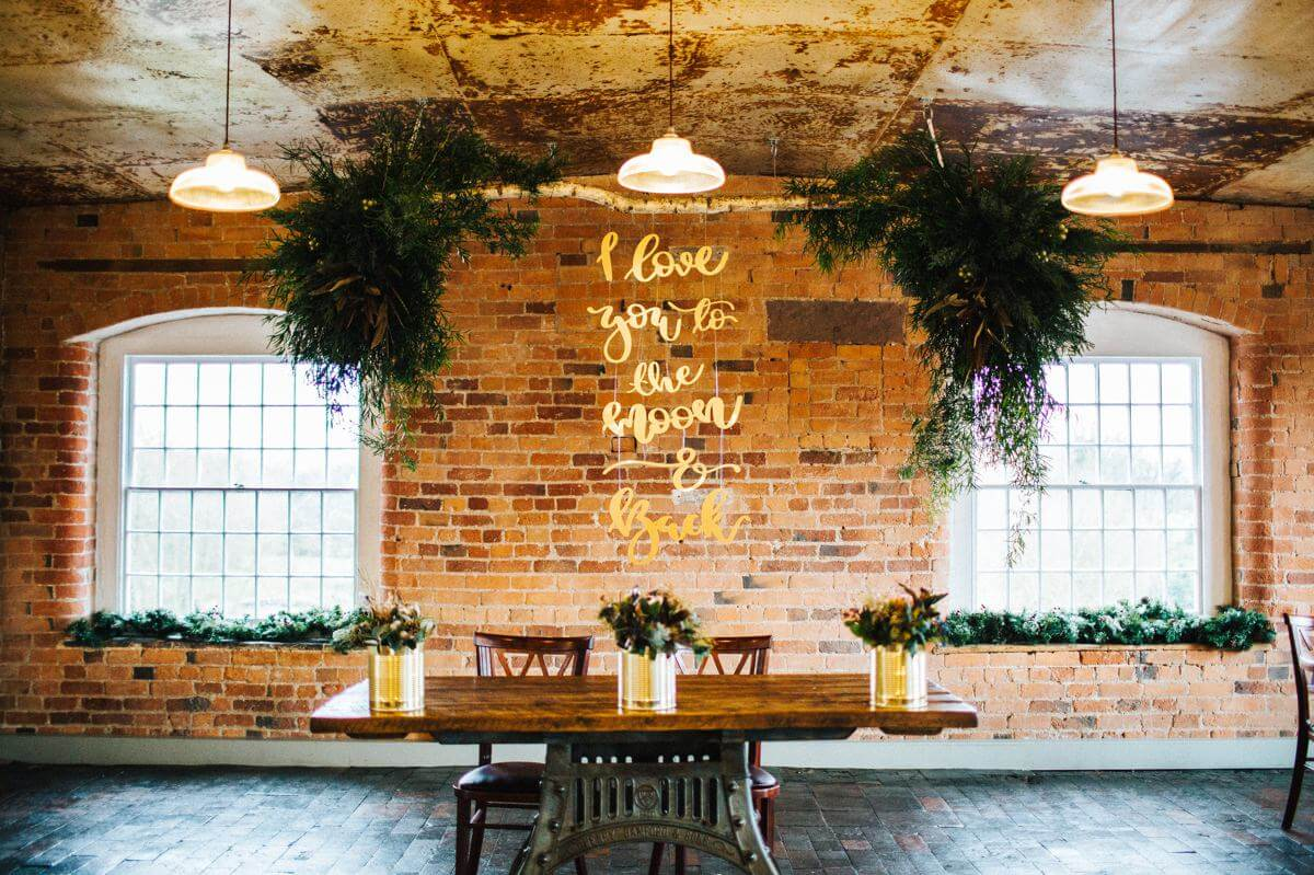 Gold and woodland wedding ceremony sign.