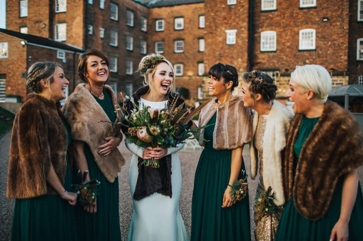 Bridesmaids laughing in fur jackets