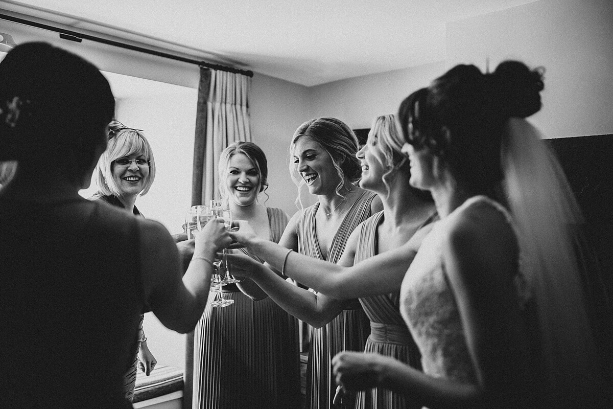 The bridesmaids laughing