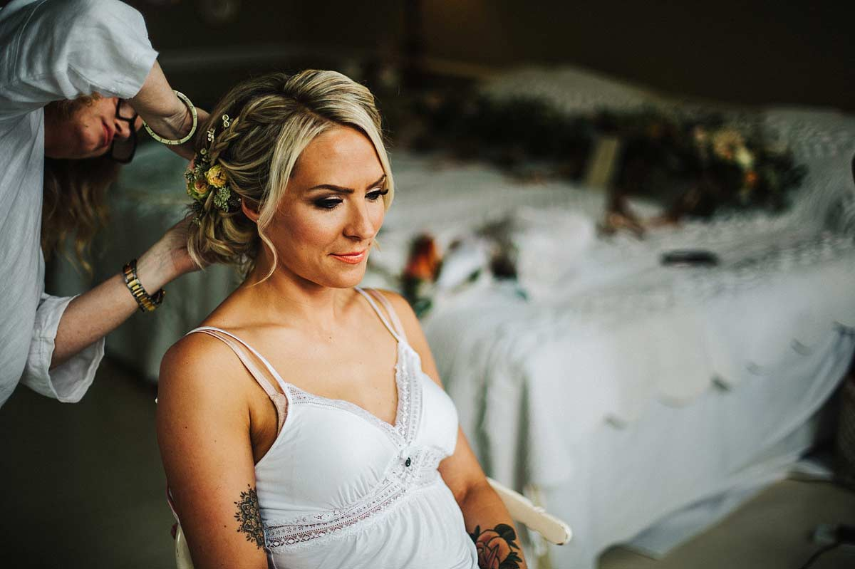 Alison Jenner Makeup fixing the bride's floral hairpiece