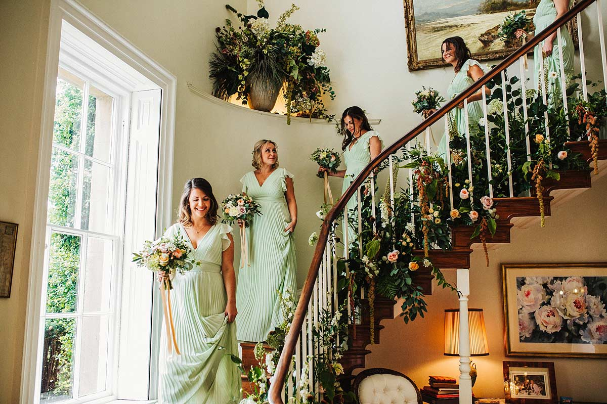 Bridesmaids walking downstairs for the ceremony