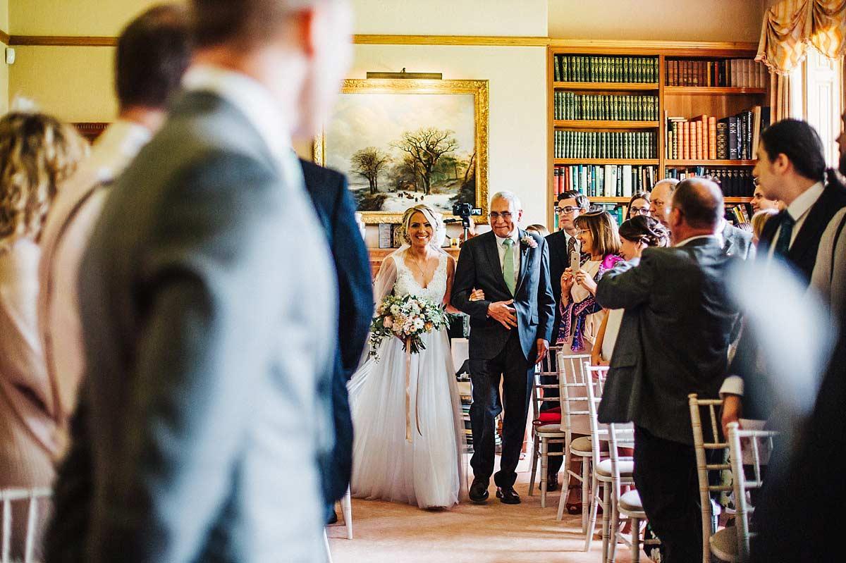 Beautiful bride walking down the aisle