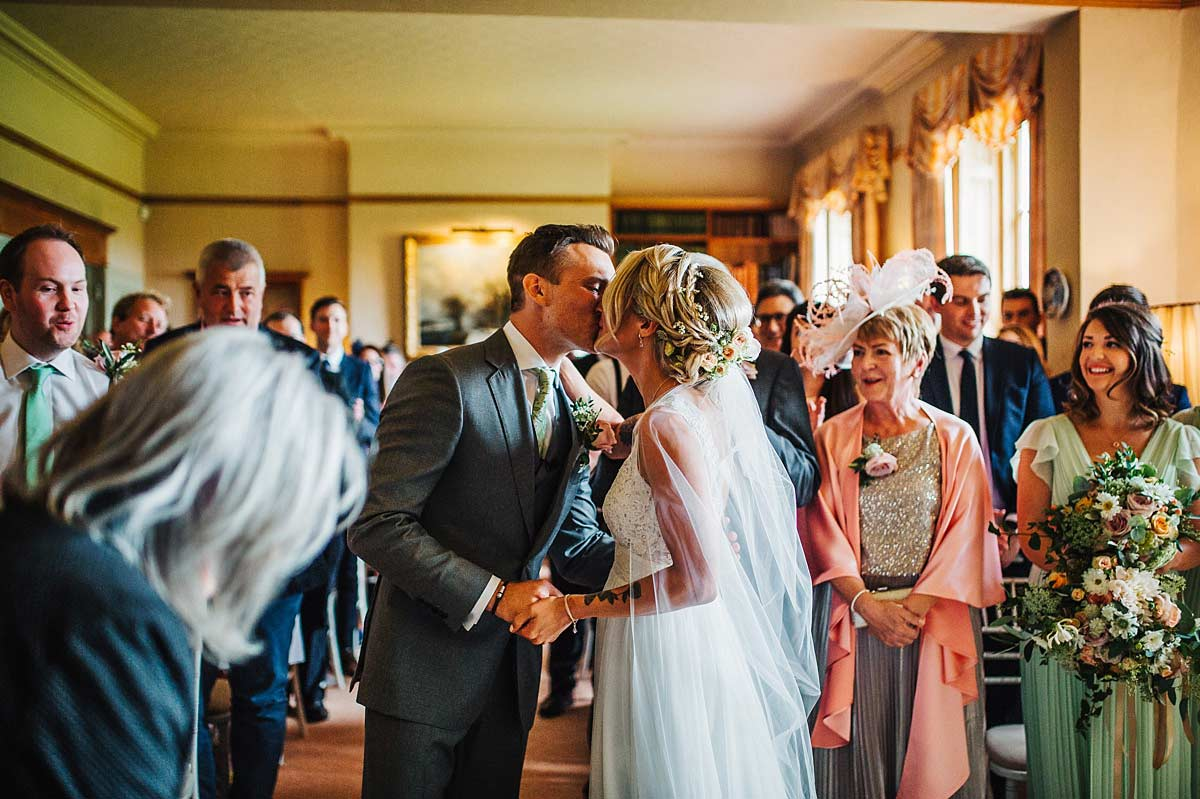 Photo of the bride and groom's first kiss