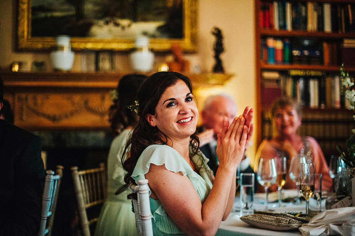 The bridesmaid clapping at the speeches