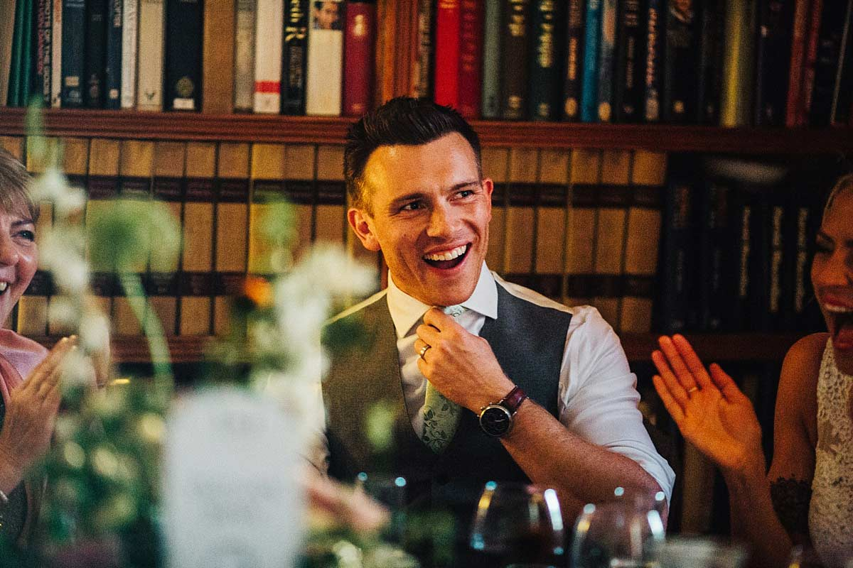 The groom laughing during speeches