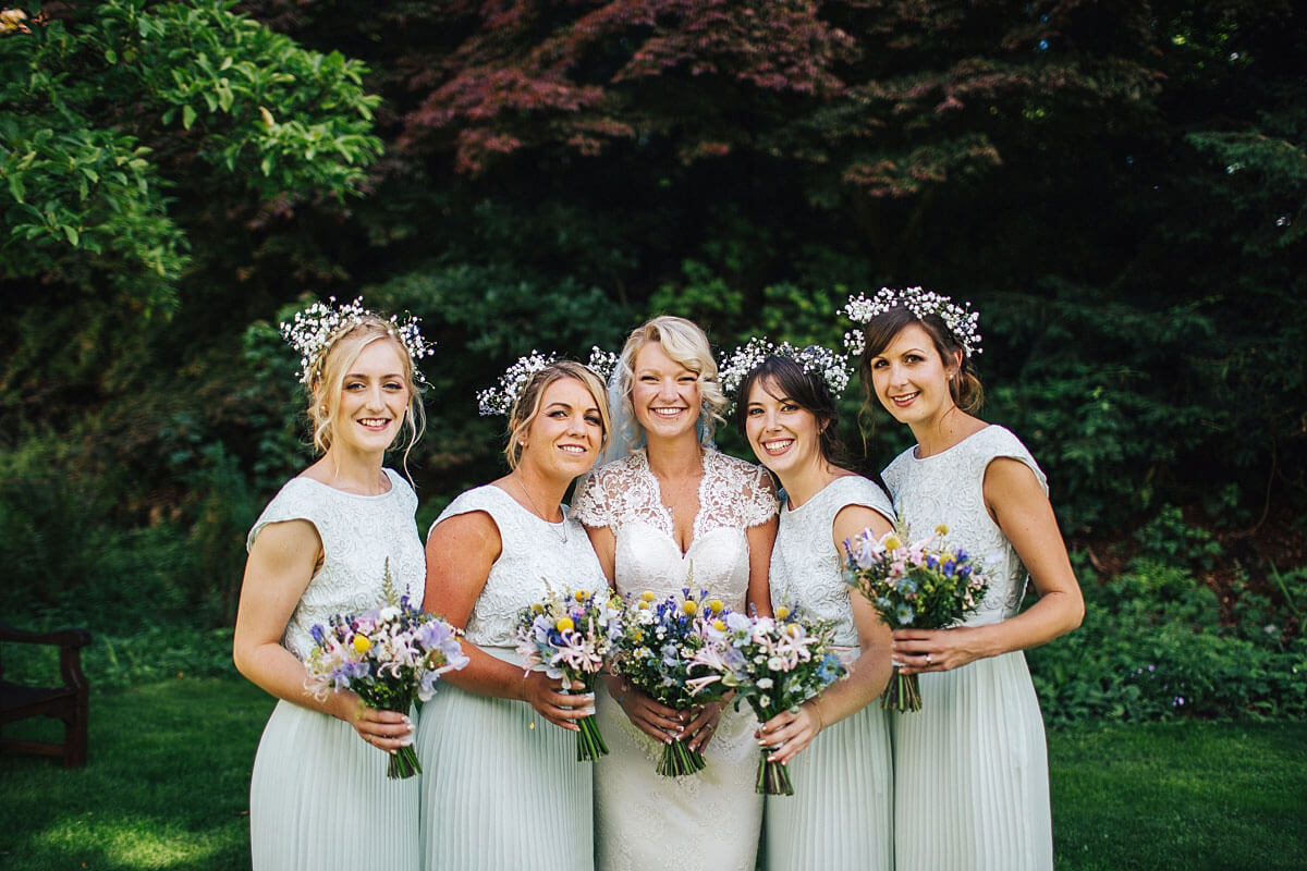 Beautiful bridesmaids with colourful bouquets at Storrs Hall