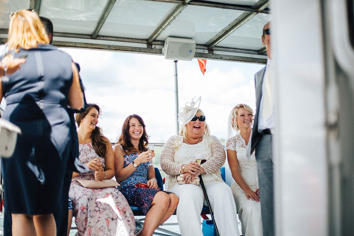 Guests enjoying the wedding boat ride across Lake Windermere