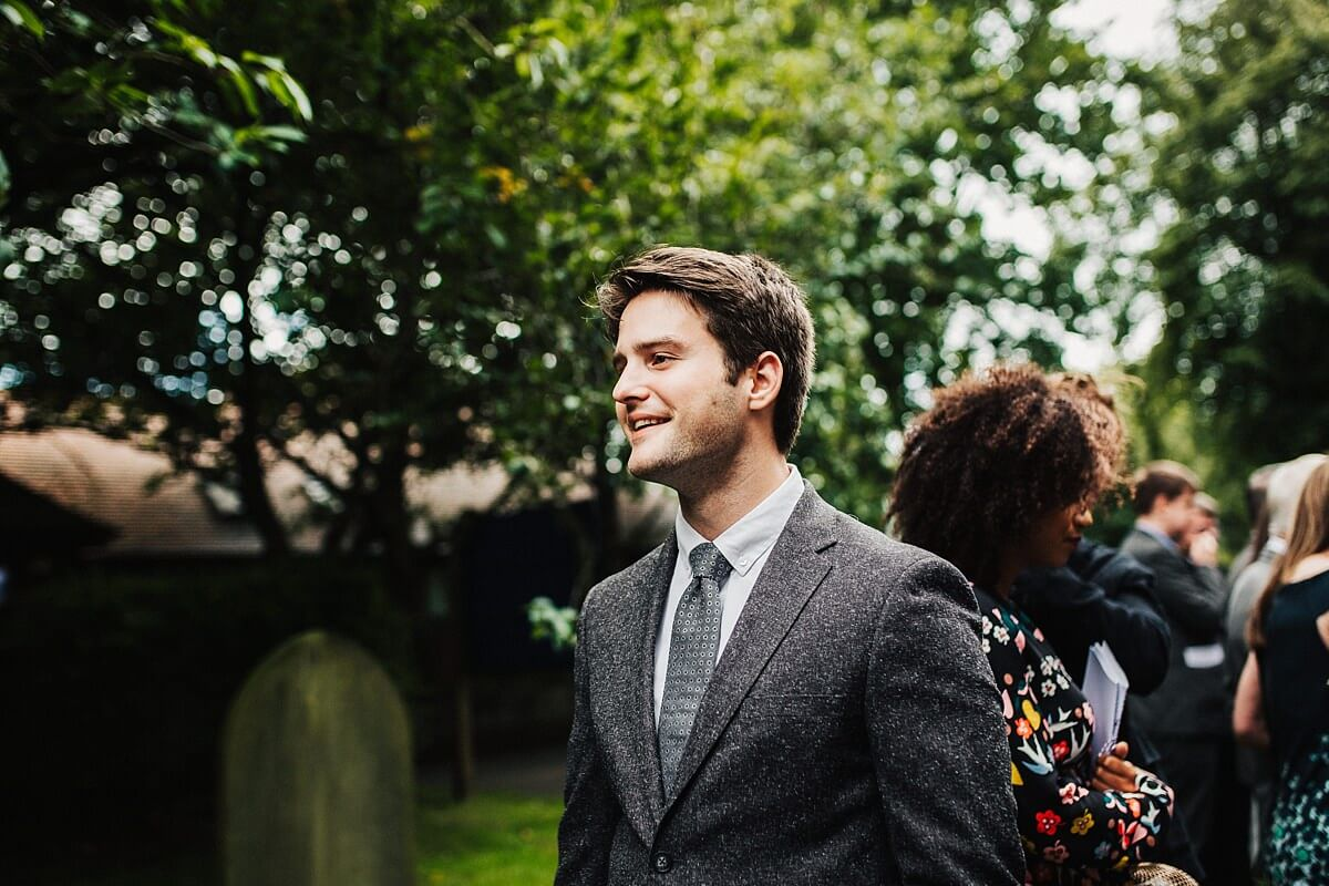 Guests smiling outside church