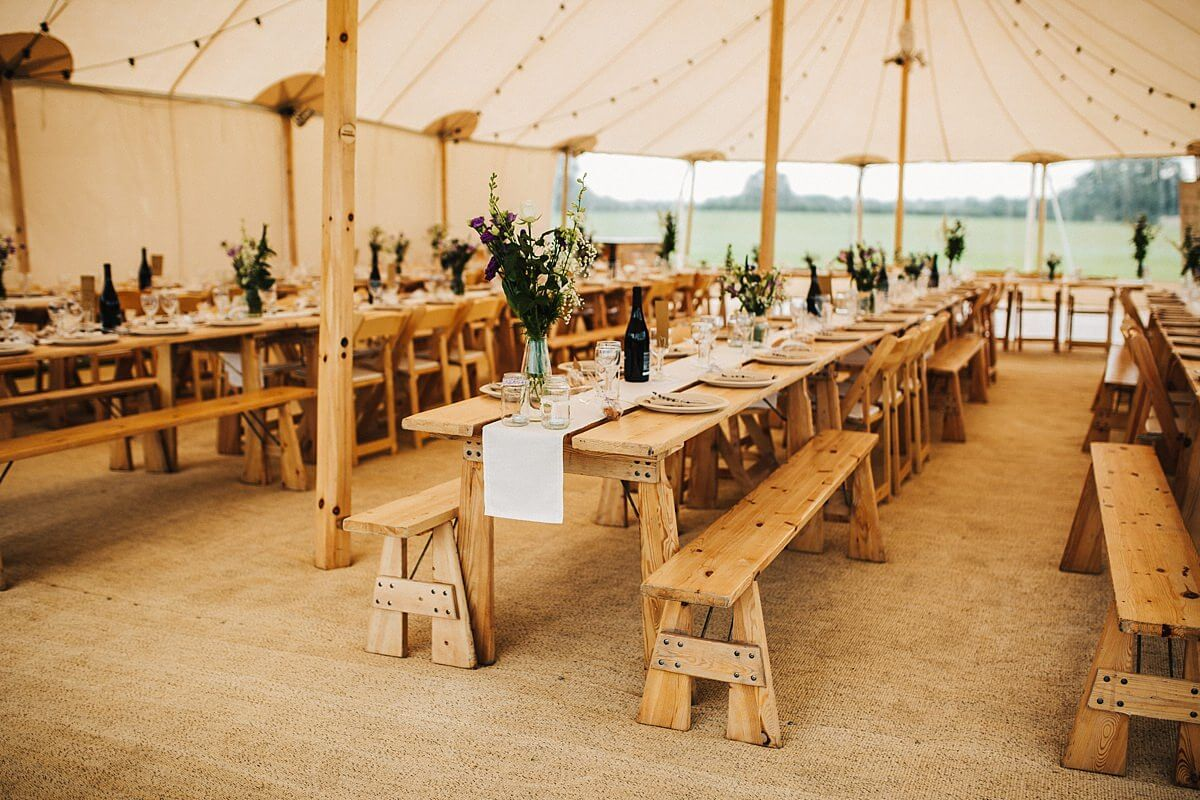 Trestle tables in the wedding marquee