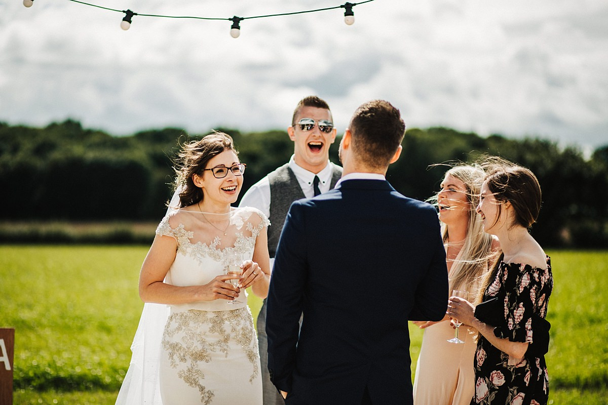 The Bride laughing with friends