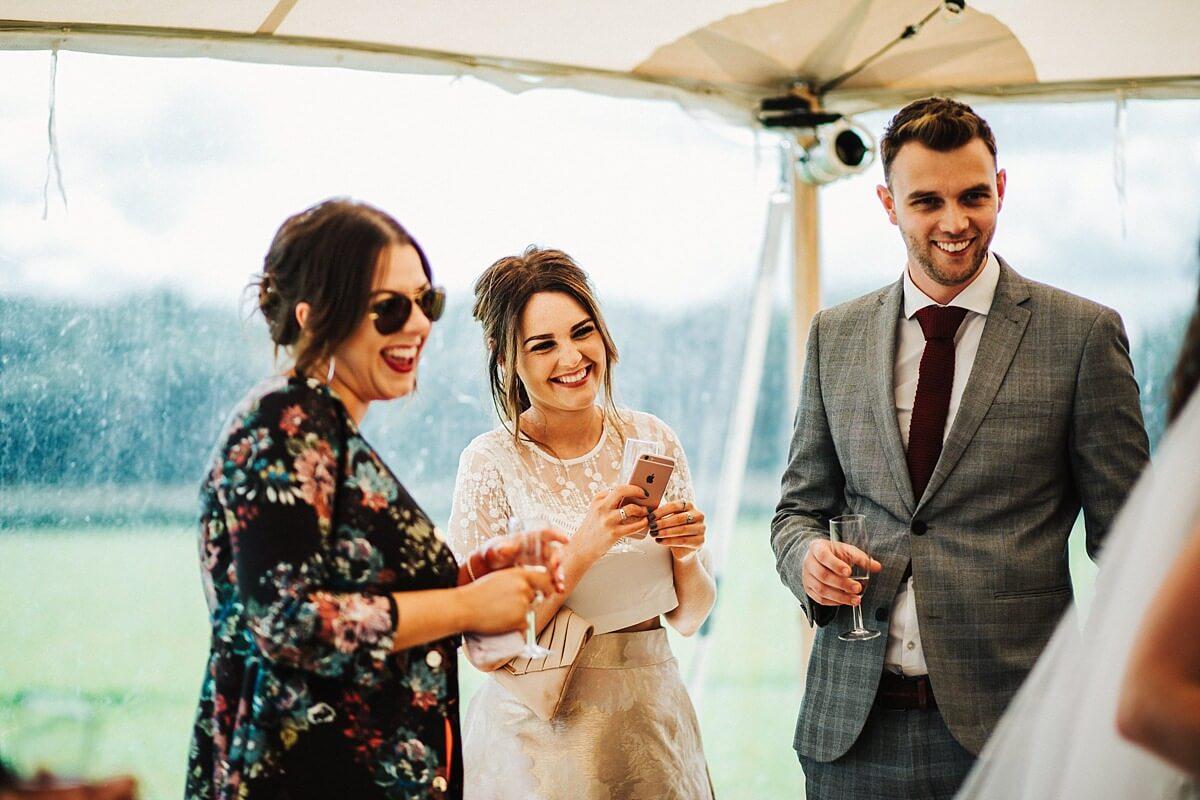 Guests enjoying the outdoor wedding
