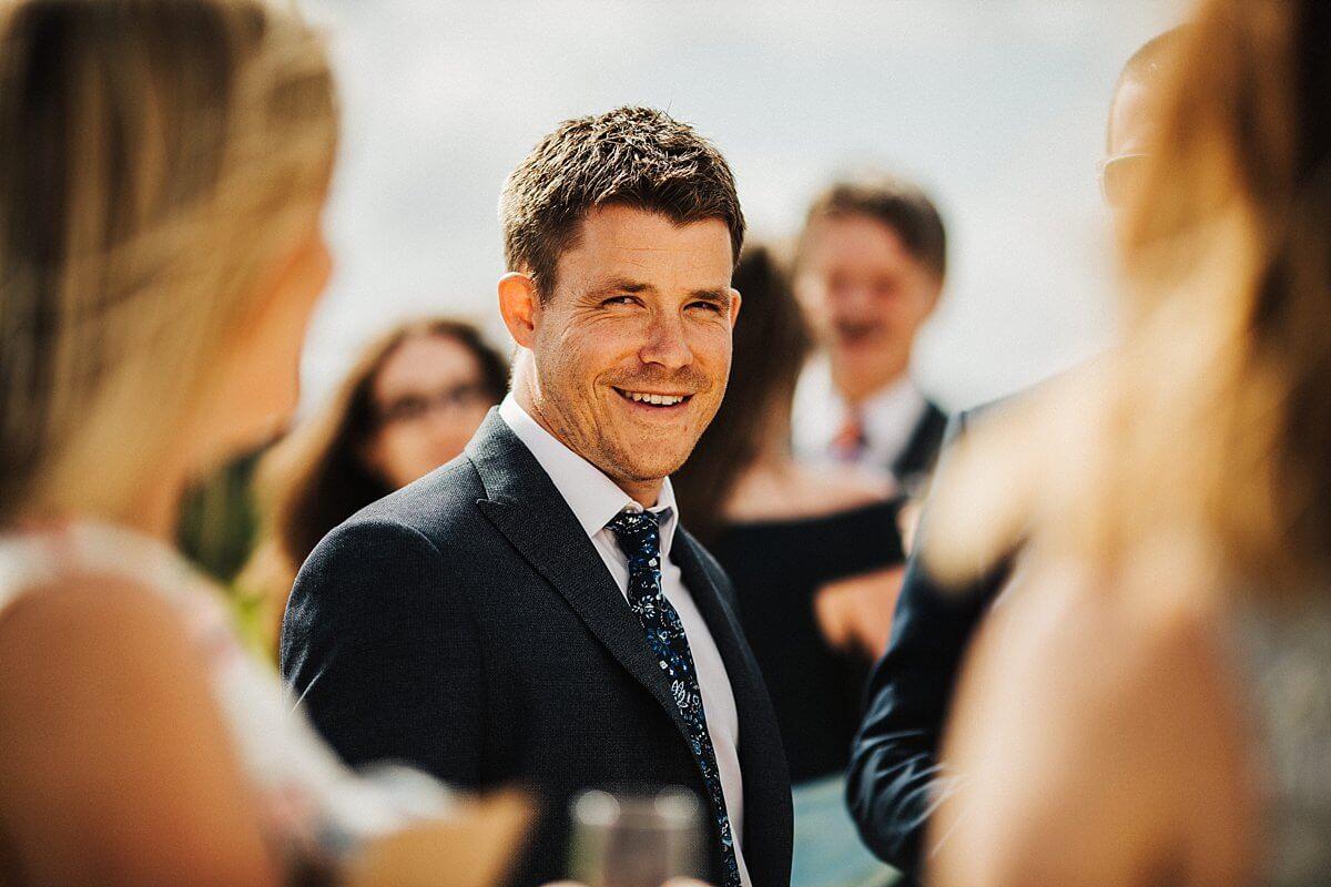 Wedding guest enjoying the sunshine