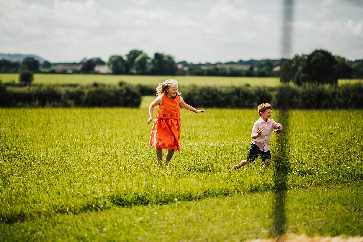 Children playing outside the marquee