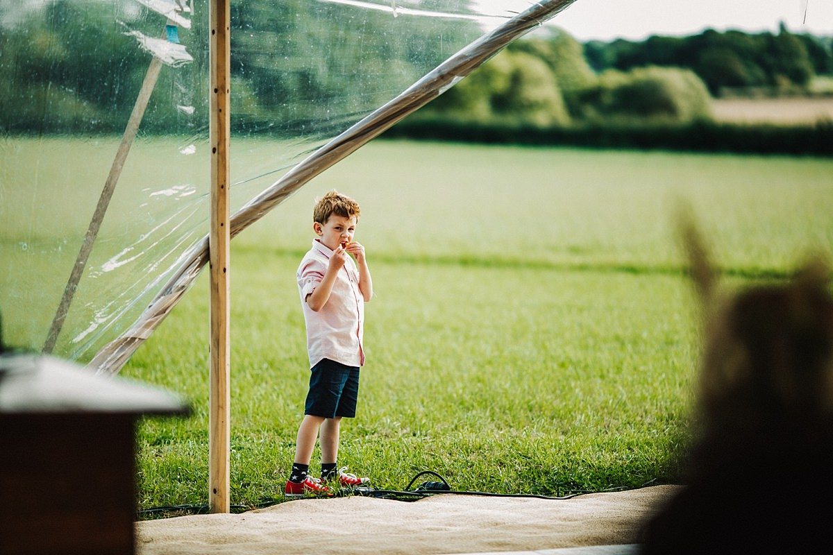 Child playing outside the marquee