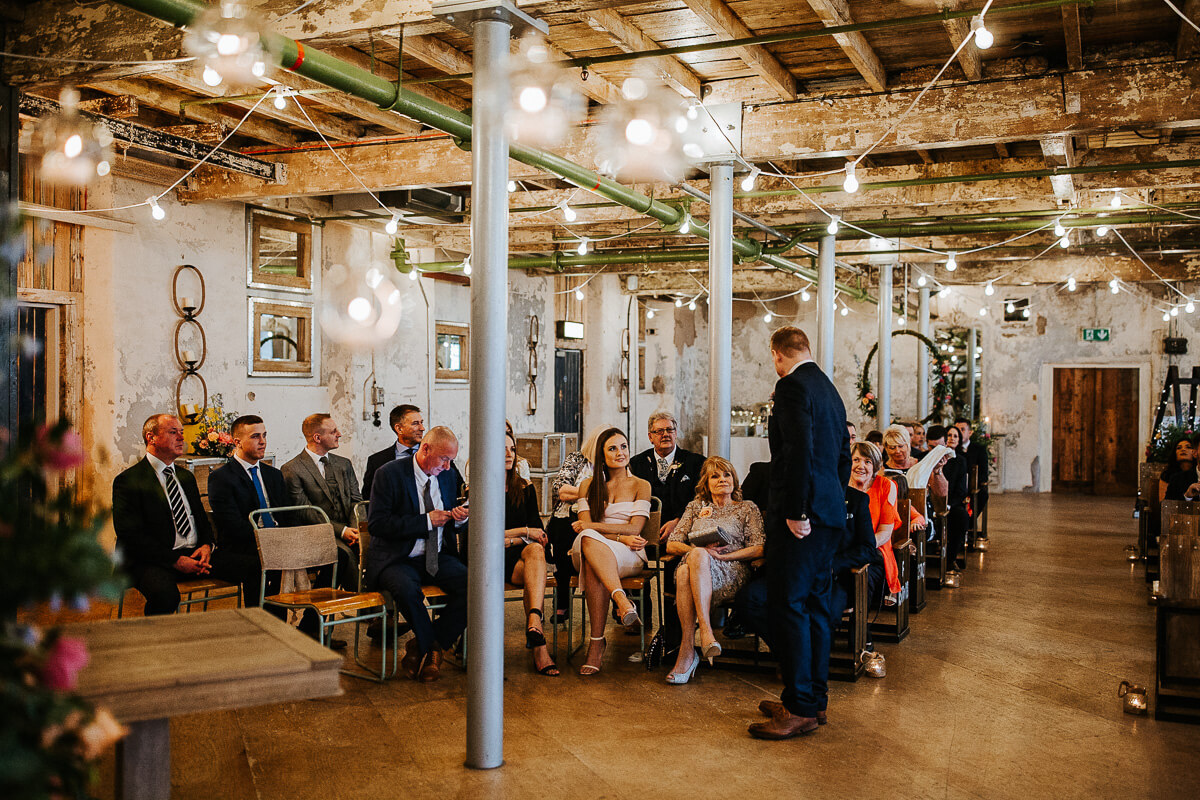 The guests seated for the ceremony at Holmes Mill