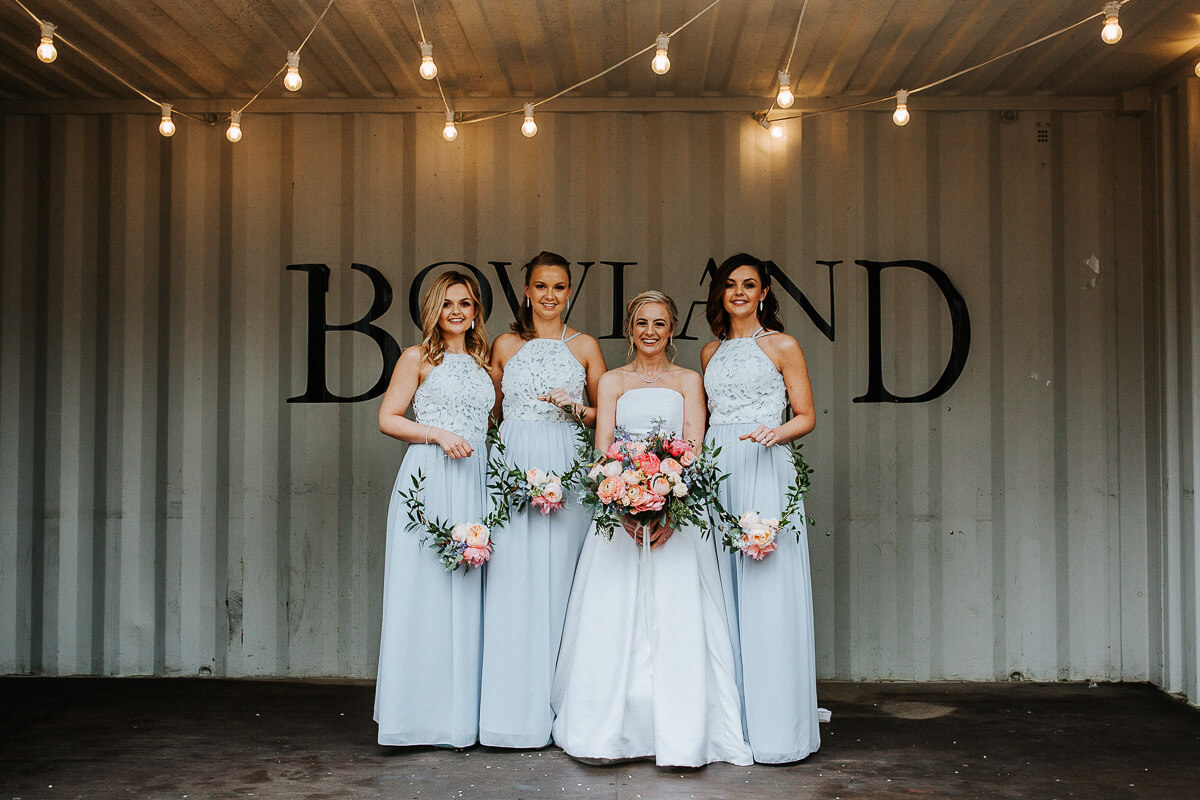 Bridesmaids with floral copper hoops