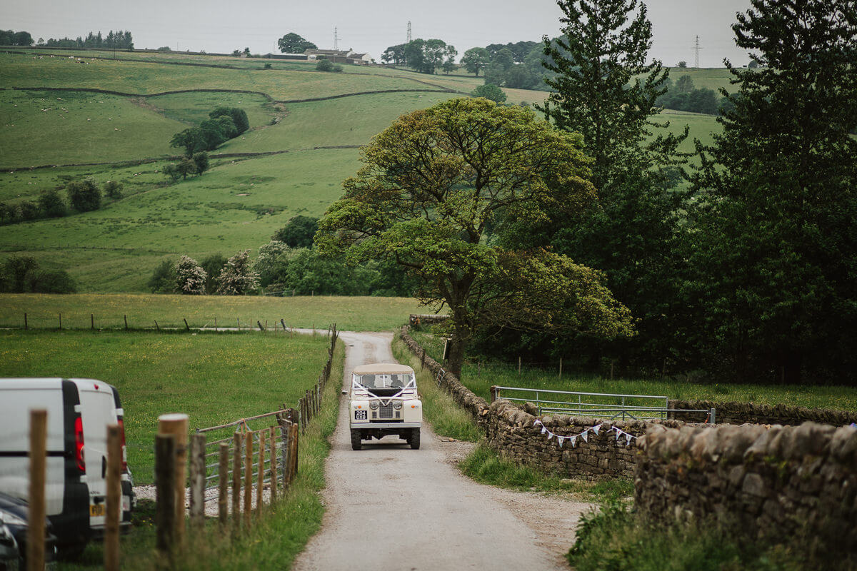 Wedding car arriving at the farm