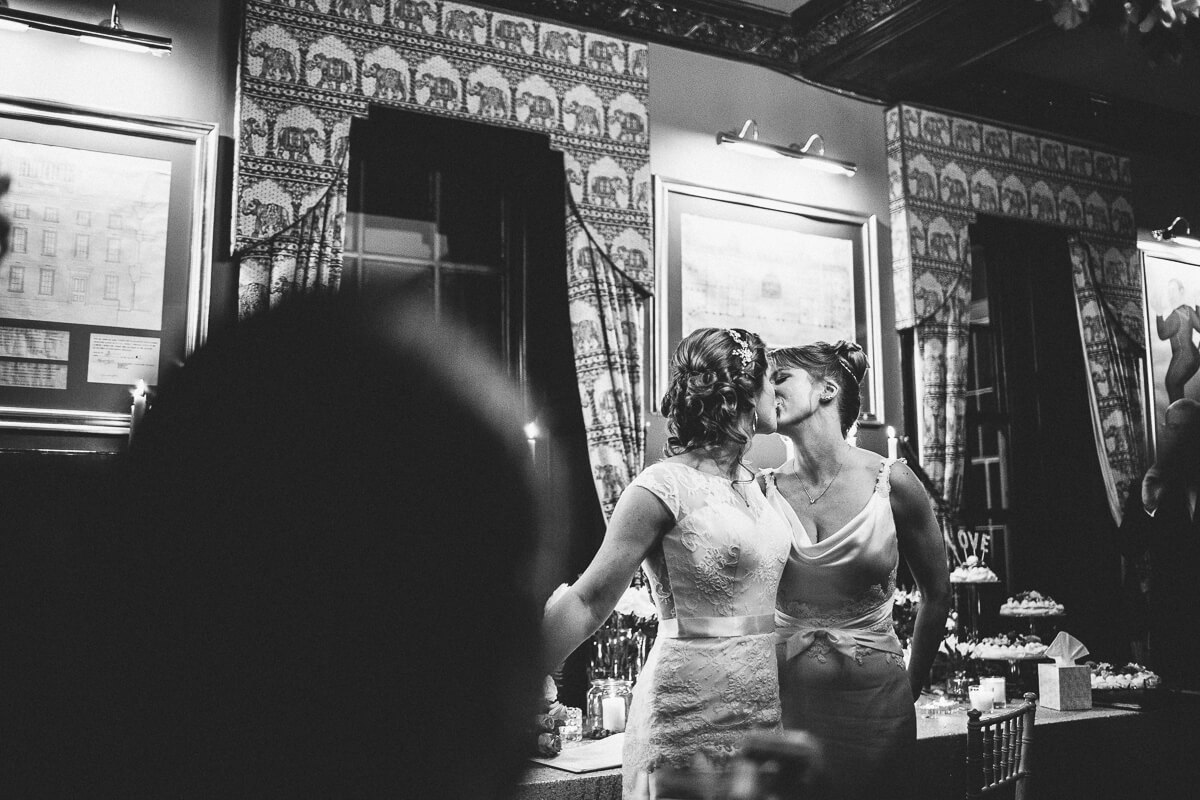 Brides kissing after the ceremony