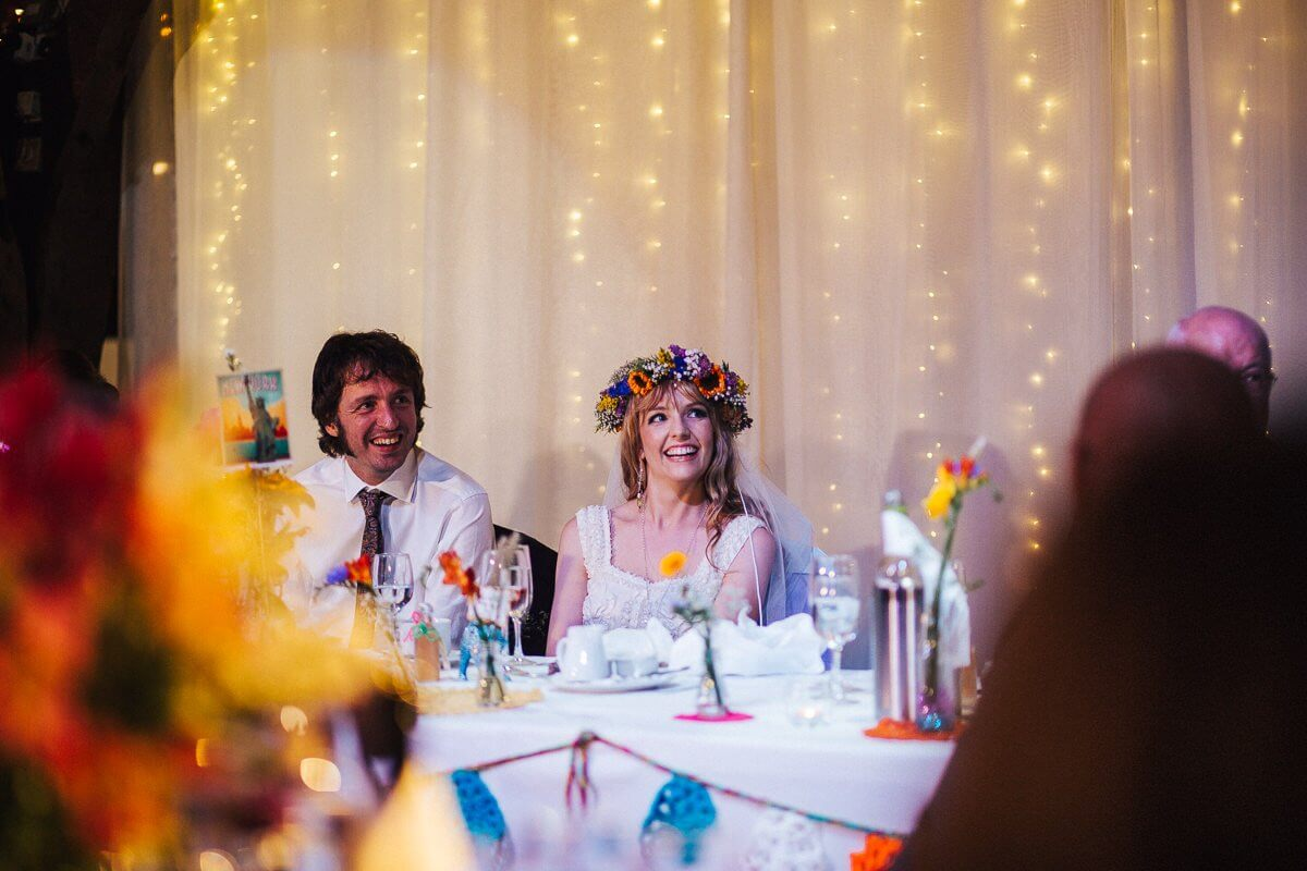 Boho bride laughing