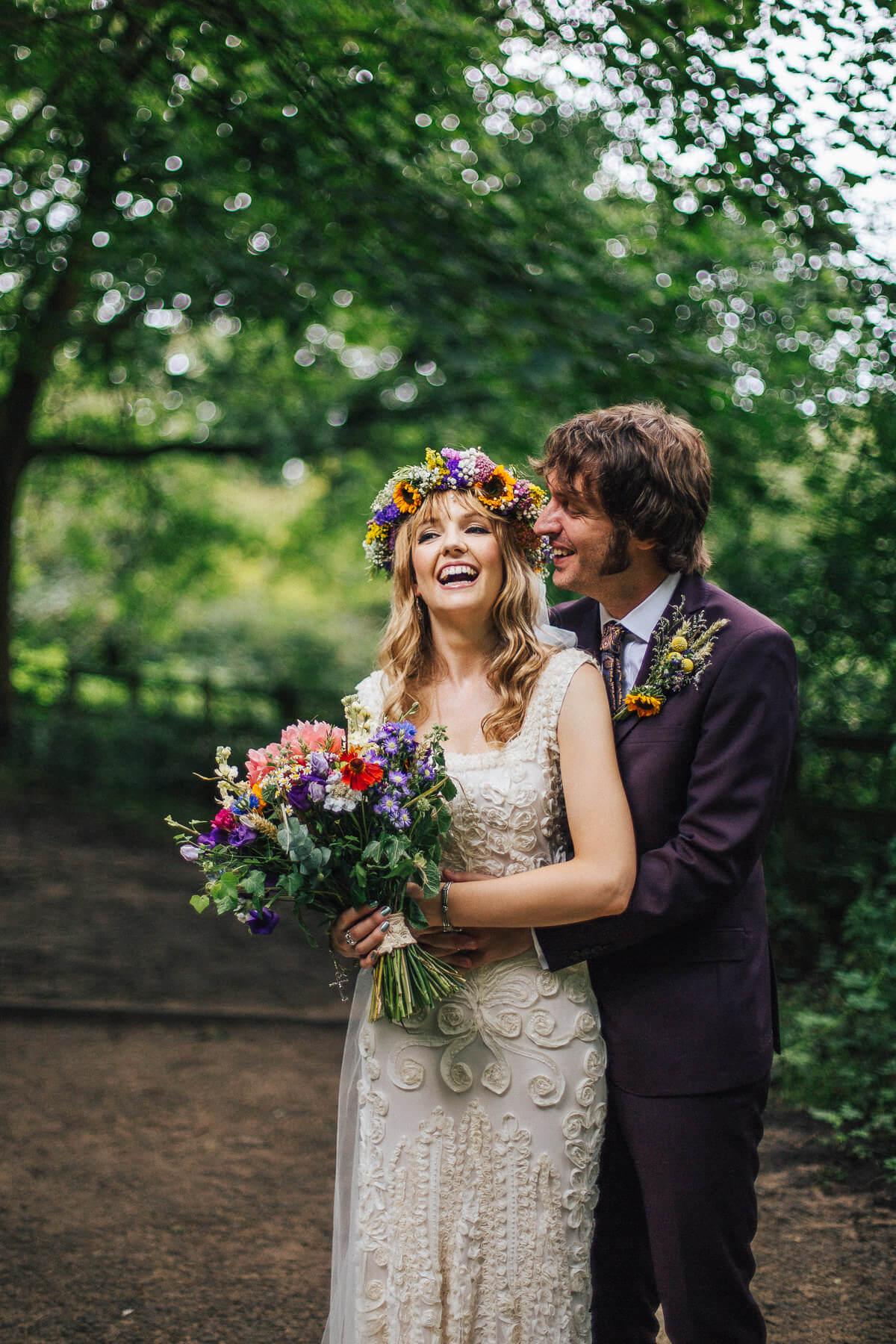 Boho bride wearing a sunflower flower crown