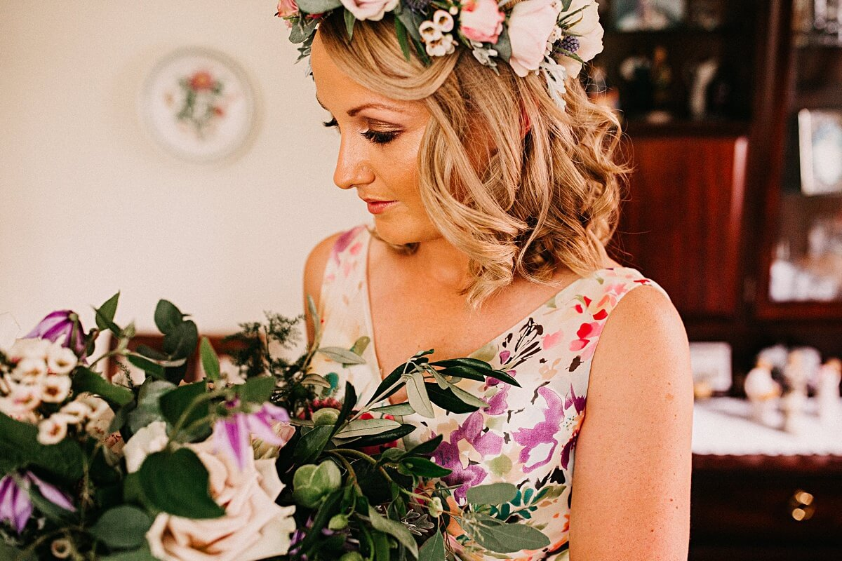 Boho bride wearing a flower crown and floral dress