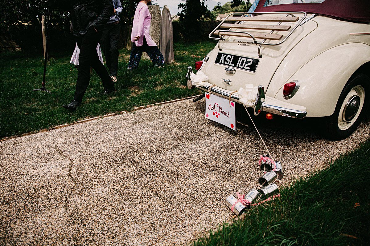 Detail of the wedding car and tin cans