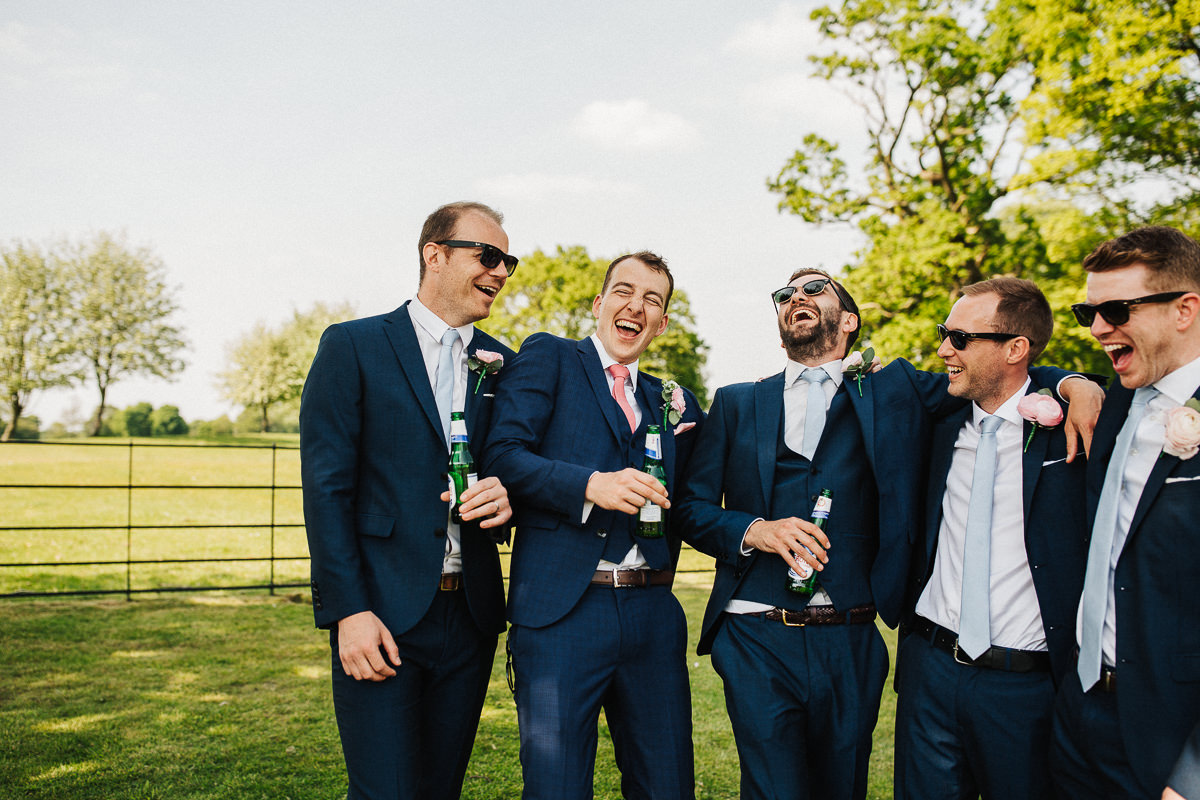Grooms laughing during portraits at Merrydale Manor