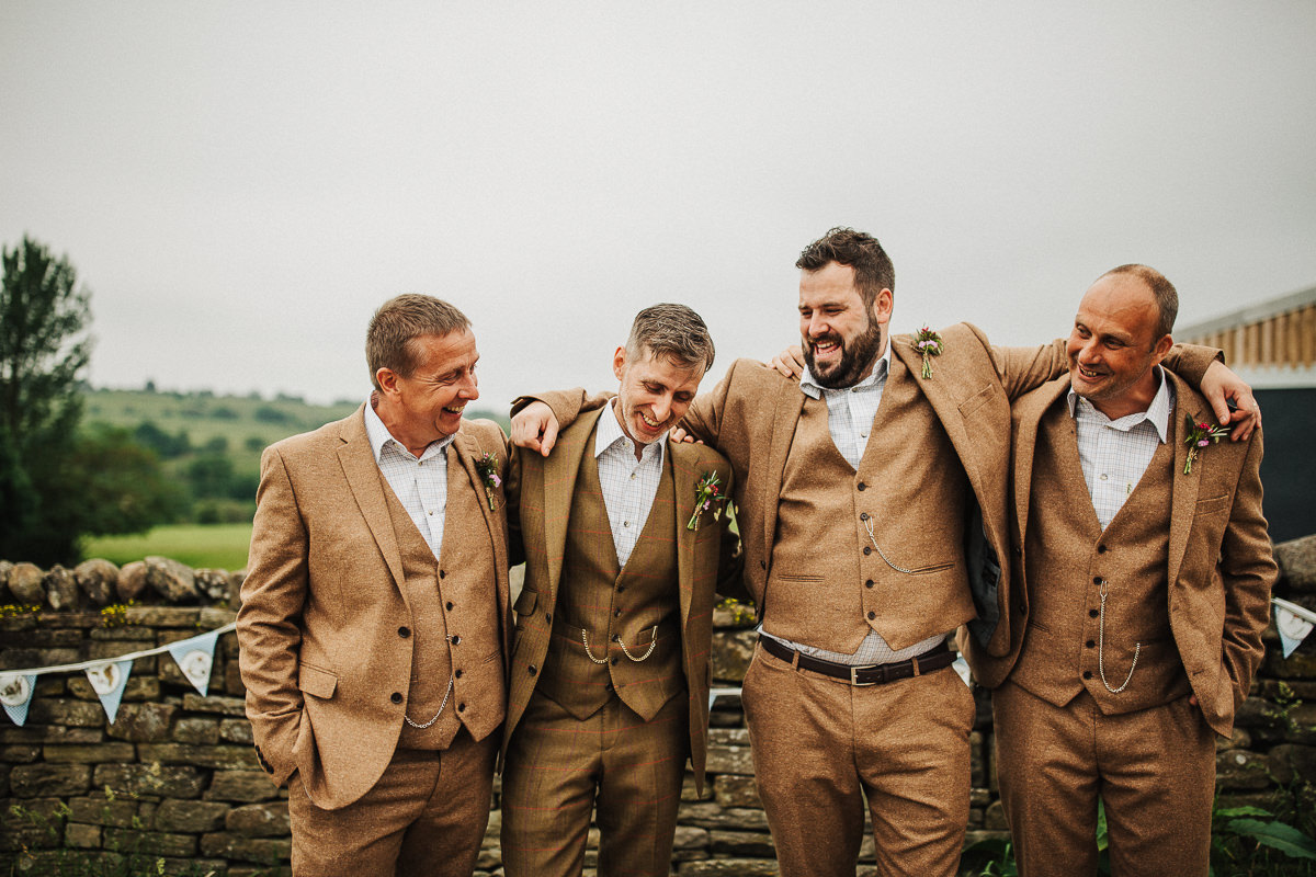 Groom and ushers wearing brown tweed suits