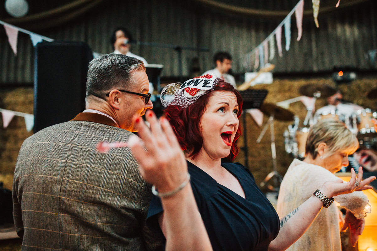 Guests dancing at the farm wedding