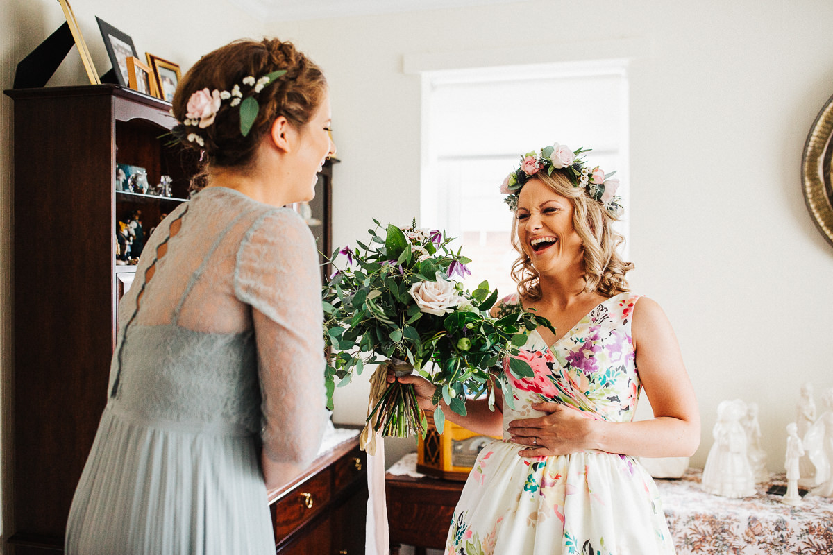 Boho bride wearing flower crown and flower dress