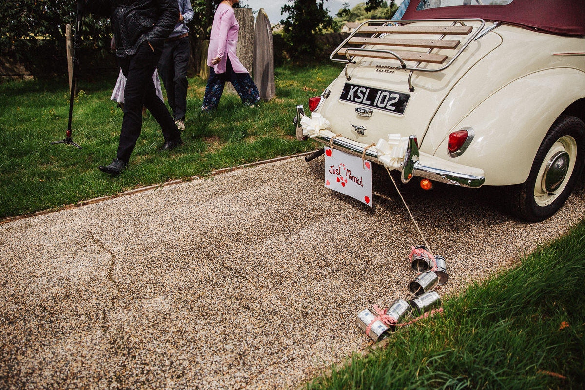 Tin cans on the wedding car